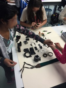 Students deconstructing a camera