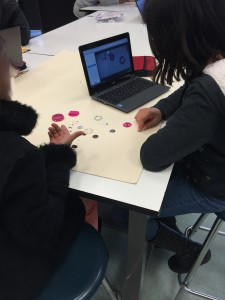 Students deconstructing a digital watch